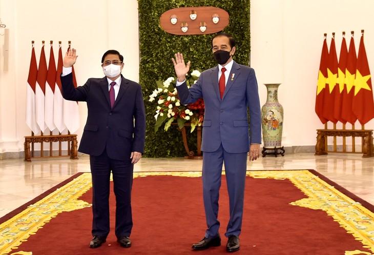 PM Vietnam, Pham Minh Chinh Lakukan Pertemuan Bilateral Dengan Presiden Indonesia, Joko Widodo - ảnh 1