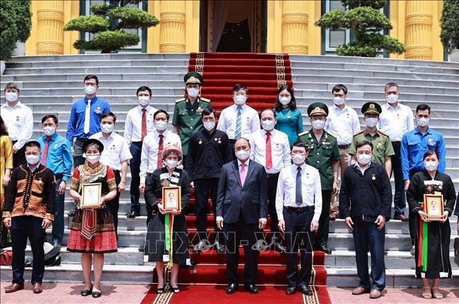 Presiden Nguyen Xuan Phuc Tegaskan Perlu Terus Kembangkan Semangat Persatuan Besar Bangsa - ảnh 1