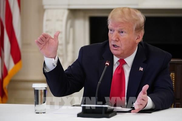 Trump threatens new taxes on companies that make goods outside US - ảnh 1