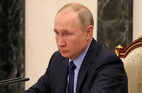 Presiden Rusia, Vladimir Putin menandatangani dekrit pelaksanaan pemungutan suara tentang revisi UUD - ảnh 1