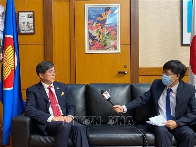 Jepang menekankan tuntutan berbagi informasi untuk melawan wabah Covid-19 - ảnh 1