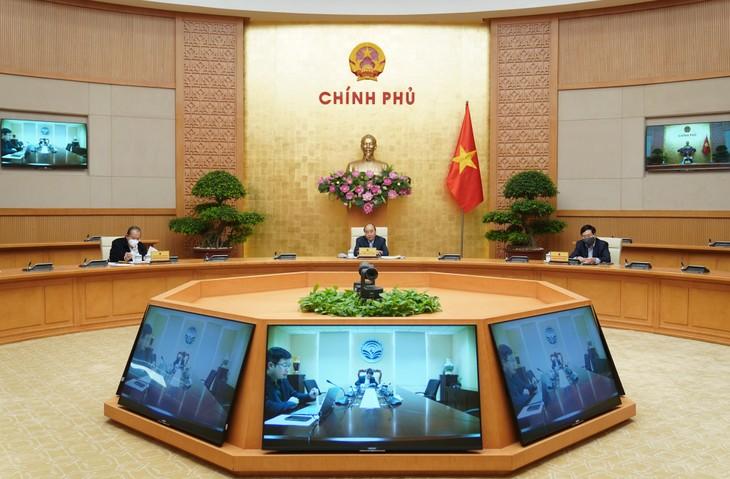 Pembukaan Konferensi antara PM dengan badan-badan usaha untuk mengawali kembali perekonomian menghadapi wabah Covid-19 - ảnh 1