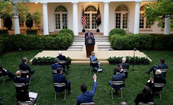 Presiden AS, Donald Trump mengumumkan petunjuk untuk membuka kembali perekonomian - ảnh 1
