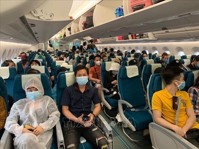 Memulangkan warga Vietnam dari Malaysia kembali ke Tanah Air - ảnh 1