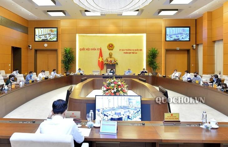 Komite Tetap MN Vietnam memberikan pendapat terhadap rancangan resolusi tentang penyesuaian taraf pengurangan pajak pendapatan pribadi karena situasi keluarga - ảnh 1