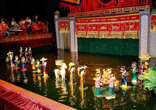 Memperkenalkan sepintas tentang Agama Cao Dai dan wayang golek air - ảnh 2