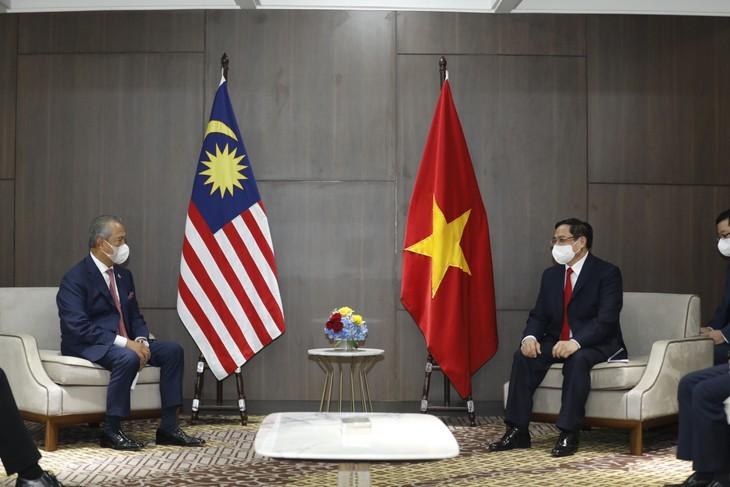 PM Vietnam, Pham Minh Chinh Lakukan Pertemuan Bilateral Dengan PM Kamboja, PM Malaysia, dan PM Singapura - ảnh 2