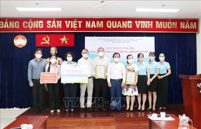 Kota Ho Chi Minh Terima Dukungan Dana Pencegahan dan Penanggulangan Wabah Covid-19 dari Badan Usaha - ảnh 1