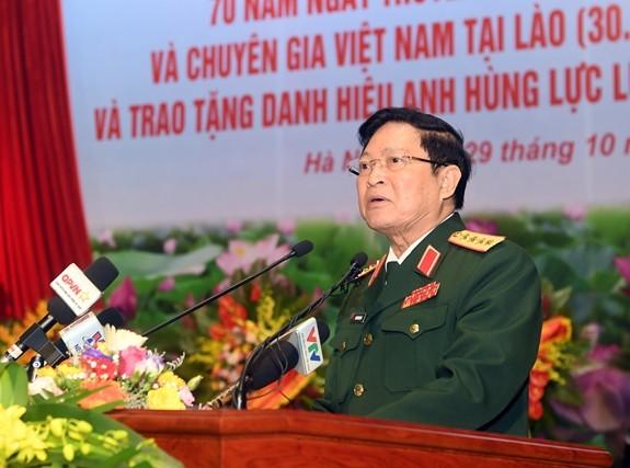 Feier zum 70. Traditionstag der vietnamesischen freiwilligen Soldaten und Experten in Laos - ảnh 1