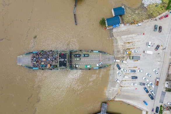 Vietnamesische Regierung unterstützt die von Fluten betroffenen Gebiete in China mit Geldern - ảnh 1