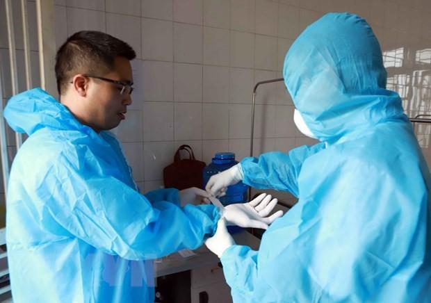 빈쑤엔에서 코로나 19 전염병 예방업무를  수행하고 있는 의료진 - ảnh 2