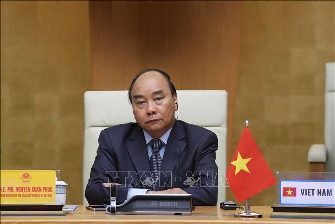 응우옌 쑤언 푹 총리, 코로나 19 대응 관련 G20 화상 정상회의 참석 - ảnh 1