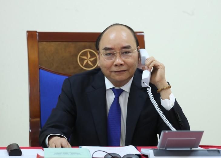 베트남-프랑스, 코로나19 방역 및 쌍방관계 촉진에 협력 - ảnh 1