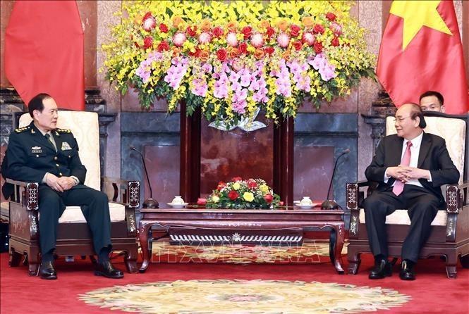 응우옌 푸 쫑 서기장과 응우옌 쑤언 푹 국가주석, 중국 국방부 장관 웨이 펑 허 상장 접견 - ảnh 2