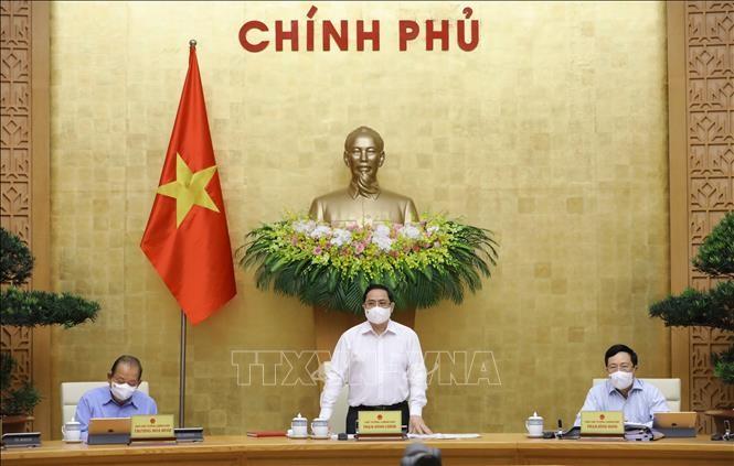 លោកនាយករដ្ឋមន្រ្តី Pham Minh Chinh អញ្ជើញដឹកនាំកិច្ចប្រជុំរដ្ឋាភិបាលប្រចាំខែមេសាឆ្នាំ ២០២១ - ảnh 1
