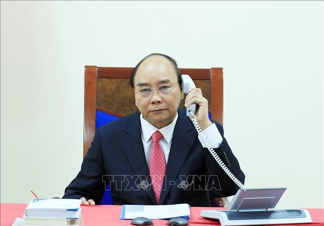 PM Vietnam, Nguyen Xuan Phuc melakukan pembicaraan telepon dengan PM Singapura, Lee Hsien Loong - ảnh 1
