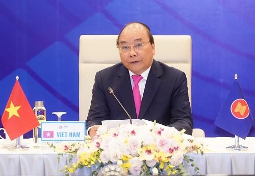 Pimpinan ASEAN berseru kepada badan usaha supaya bersinergi mengatasi kesulitan akibat Covid-19 - ảnh 1