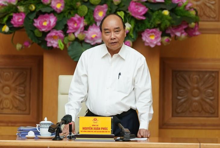 PM Nguyen Xuan Phuc. Patriotisme membantu Vietnam mengatasi kesulitan - ảnh 1