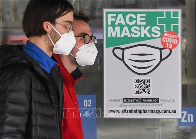 Kalangan ilmuwan menegaskan efektivitas masker dalam mencegah dan menanggulangi wabah Covid-19 - ảnh 1