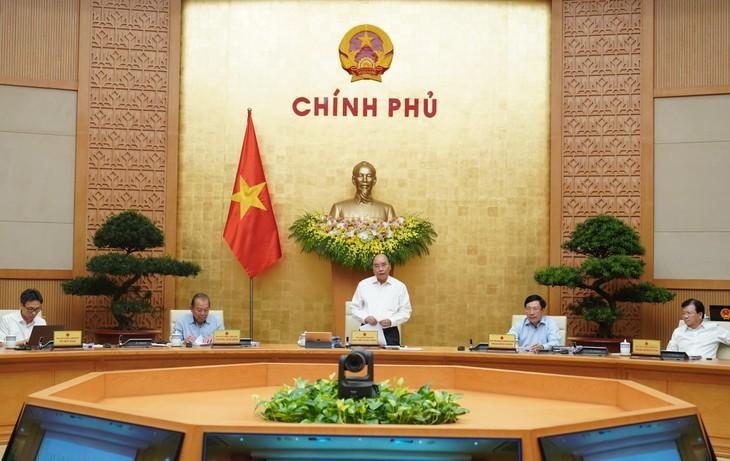 PM Nguyen Xuan Phuc: Pertumbuhan ekonomi Vietnam diprediksi menduduki posisi ke-5 di dunia pada tahun ini - ảnh 1