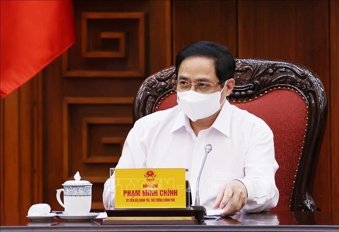 Perdana Menteri Memimpin Sidang Badan Harian Pemerintah tentang pencegahan dan pengendalian COVID-19 - ảnh 1