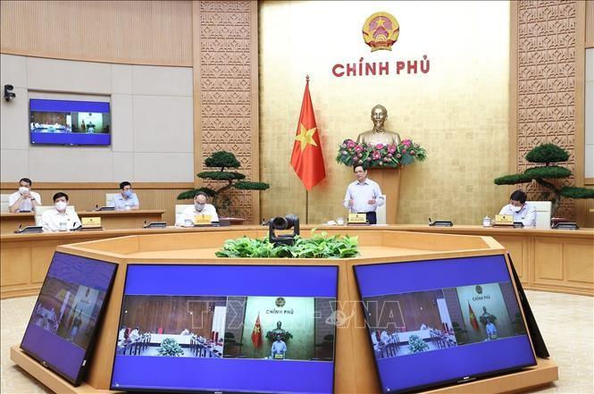 Perdana Menteri Pham Minh Chinh Tegaskan Pemerintah Akan Segera Memproduksi Vaksin di Dalam Negeri - ảnh 1