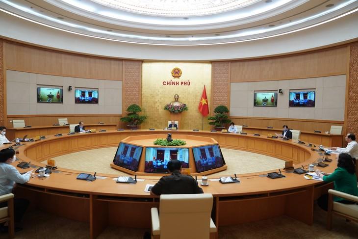 越南政府常务委员会举行会议 讨论新冠肺炎疫情防控工作 - ảnh 1