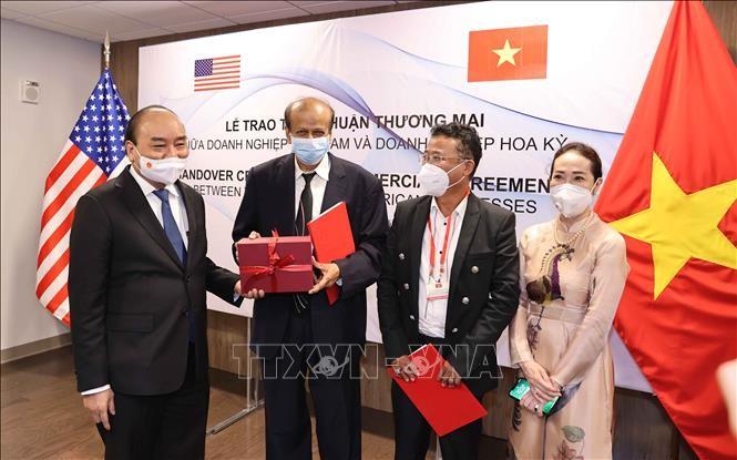 越南国家主席阮春福出席越美企业合作协议文本互换仪式 - ảnh 1