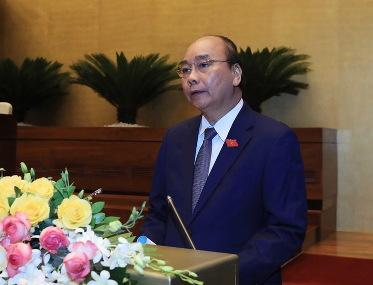 Vietnam determined to contain epidemic, develop economy - ảnh 1