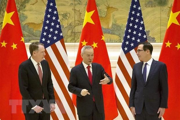 US, China postpone online talks on trade deal - ảnh 1