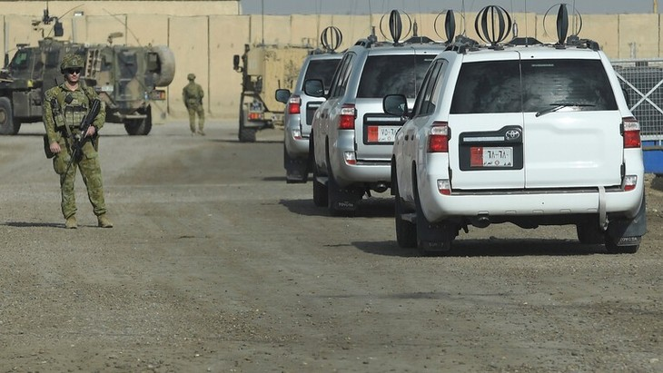 International alliance forces withdraw from military bases in Iraq - ảnh 1