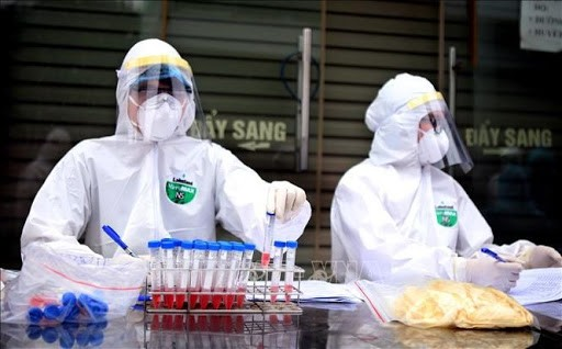 Vietnam reports first day with no new COVID-19 cases since July 25 - ảnh 1
