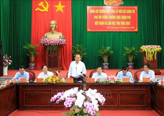 Deputi Harian PM Truong  Hoa Binh melakukan kunjungan kerja di Provinsi Vinh Long - ảnh 1