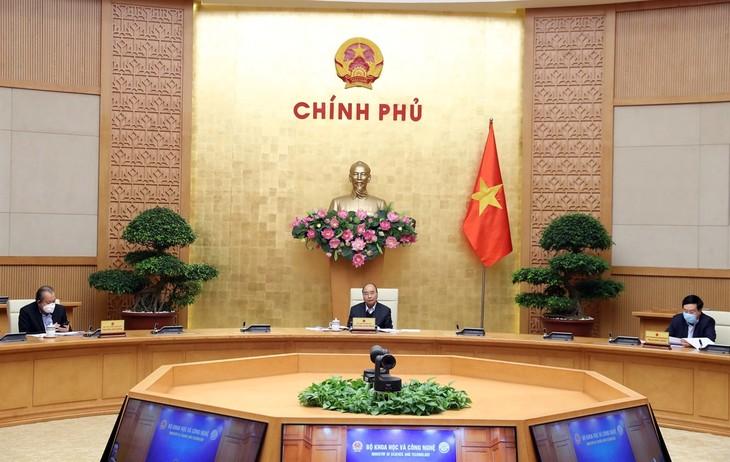 PM memimpin rapat persiapan untuk konferensi online nasional - ảnh 1