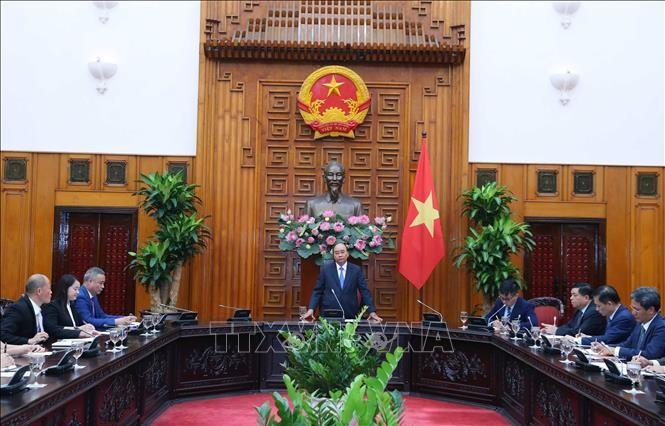 PM Nguyen Xuan Phuc menerima rombongan badan usaha Tiongkok yang melakukan investasi di Viet Nam - ảnh 1