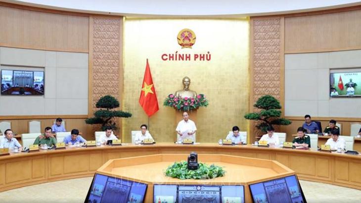 PM Nguyen Xuan Phuc melakukan temu kerja dengan Badan Pengarahan Nasional urusan Pencegahan dan Pemberantasan Wabah Covid-19 - ảnh 1