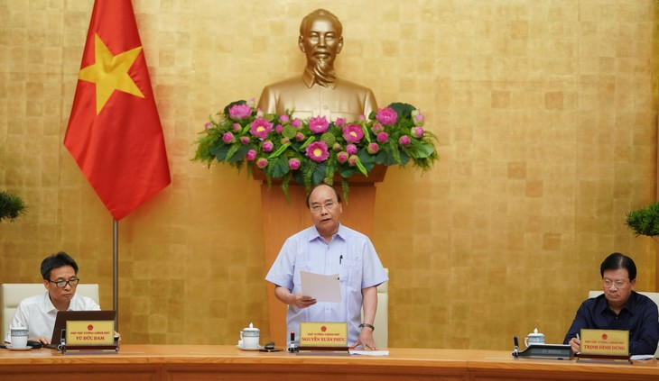 PM Nguyen Xuan Phuc: Tidak membiarkan wabah merebak dan meluas di Kota Da Nang dan daerah-daerah lain - ảnh 1