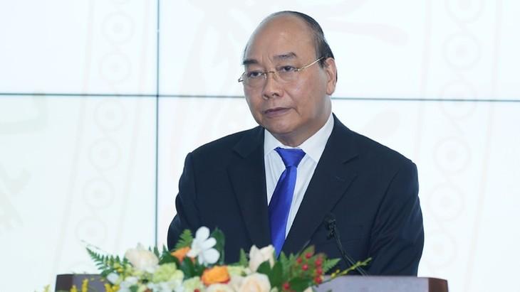 PM Nguyen Xuan Phuc: Membangun dan mengembangkan Pemerintah Digital merupakan keniscayaan - ảnh 1