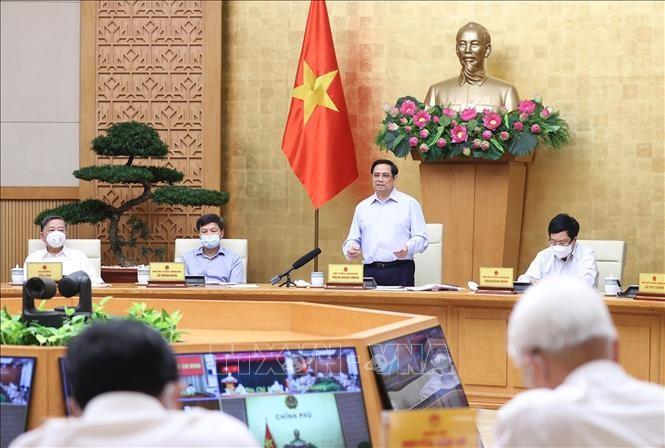PM Pham Minh Chinh: Pemerintah Terus Memberikan Kondisi Maksimal agar Kota Ho Chi Minh dan Berbagai Provinsi Cepat Memundurkan Wabah Covid-19 - ảnh 1