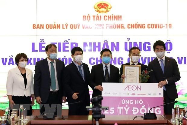Vietnamitas proporcionan más asistencia para el Fondo Nacional de Vacunas anti-coronavirus - ảnh 1