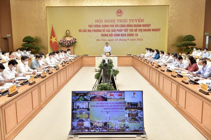 El Gobierno debate sobre soluciones al control del covid-19 para empresas y localidades - ảnh 1