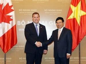 Kanada berkomitmen akan membantu Vietnam memperbaiki sistim perbankan. - ảnh 1