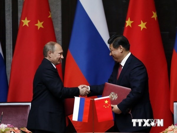 Tiongkok dan Rusia menandatangani banyak permufakatan kerjasama di bidang energi. - ảnh 1
