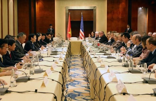 Presiden Vietnam, Truong Tan Sang menghadiri simposium dengan badan-badan usaha AS. - ảnh 1