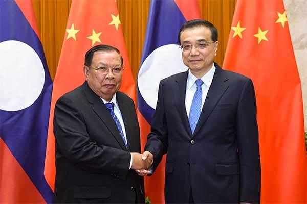 Tiongkok dan Laos  mendorong hubungan kemitraan strategis dan komprehensif - ảnh 1