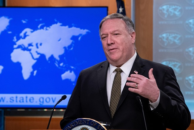 AS menuduh Tiongkok  yang menyalah-gunakan krisis wabah Covid-19 - ảnh 1