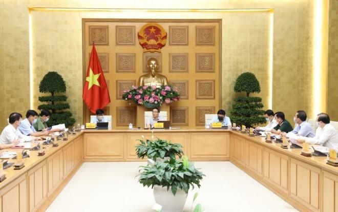 Vietnam akan menangani secara serius pelanggaran terhadap upaya mencegah dan menanggulangi wabah Covid-19 - ảnh 1