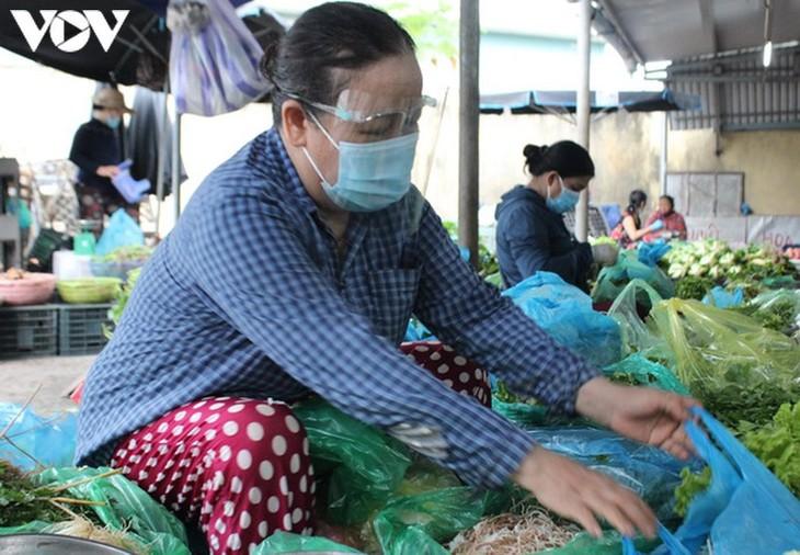 Chợ Nại Hiên Đông, Đà Nẵng mở cửa trở lại sau khi bị phong toả - ảnh 7