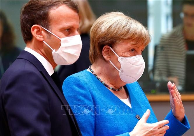 "Sommet européen: Macron et Merkel gardent ""l'espoir"" d'un compromis - ảnh 1"