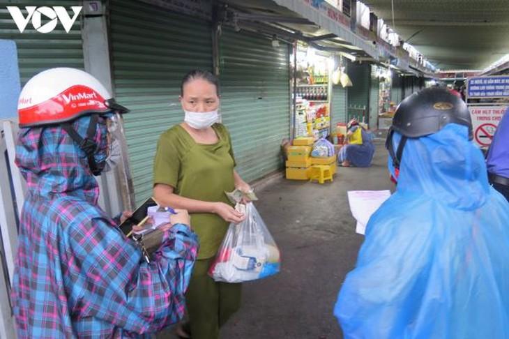 Ngày đầu tiên người Đà Nẵng dùng thẻ đi chợ phòng ngừa Covid-19 - ảnh 11